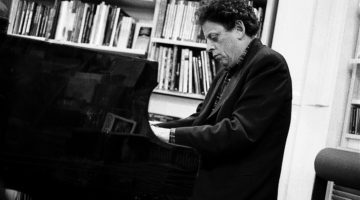Philip Glass playing the piano.