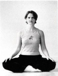 Cyndi Lee sitting in Sukhasana yoga pose
