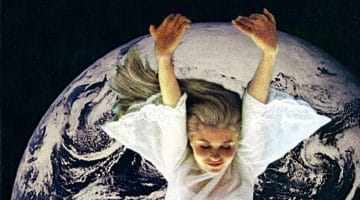 Woman floating over the earth.