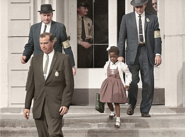 Ruby Bridges, the first African-American child to attend an all-white elementary school in the American South, escorted by U.S. Marshals dispatched by President Eisenhower for her safety. 14 November, 1960. Photo via flickr.