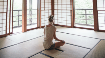 Woman sitting in a Zendo.