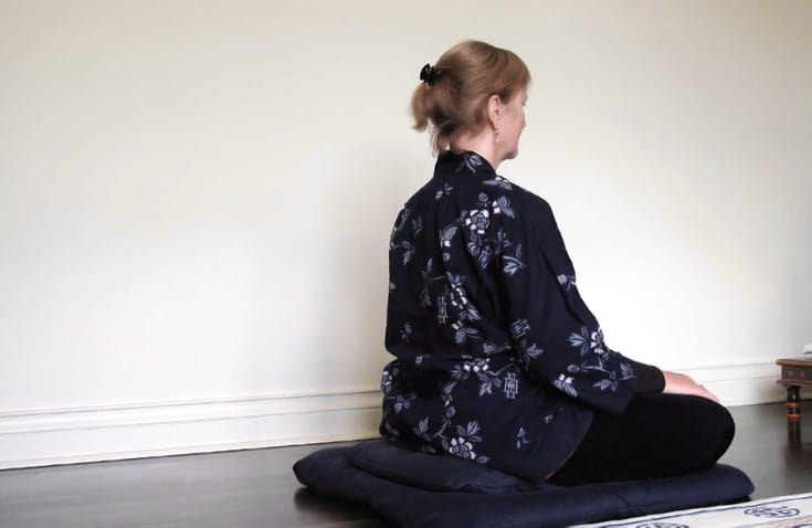 Person meditating.