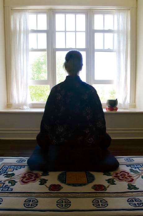 Woman meditating. Photo by Liza Matthews.