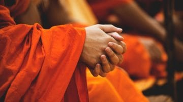 Thai monk with hands folded.
