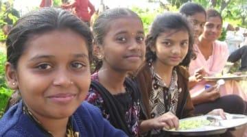 Dalit Buddhist children eating