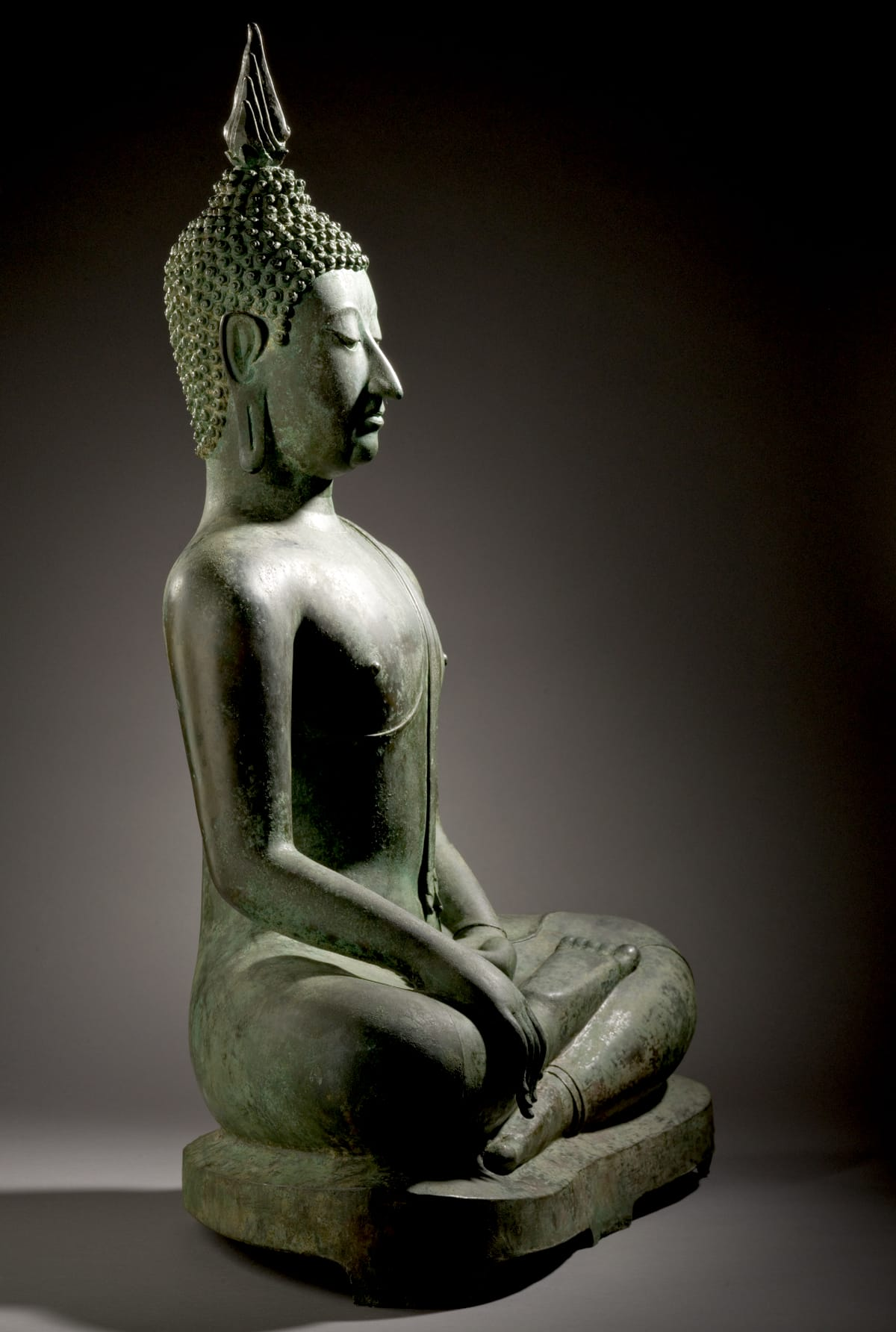 Head and shoulder of a statue of the Buddha in meditation.