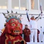 Dharma meets sports: U.S.-born Mongolian lama carries Olympic flame
