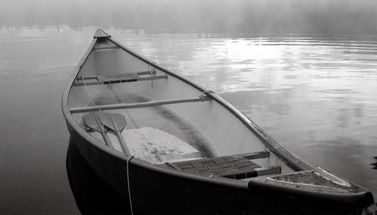Empty boat in water