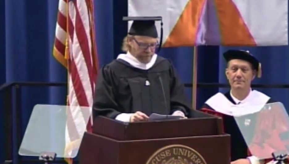 George Saunders speaking at a podium.