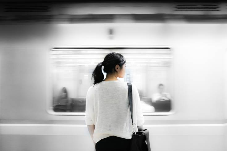 Woman standing in front of a subway.