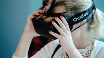 A woman wears Oculus Rift.