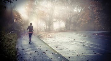 A runner in the fog.