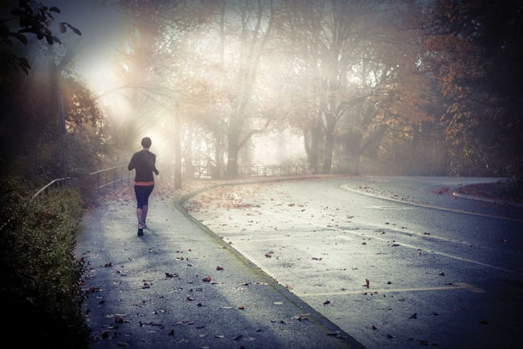 A runner in the fog.