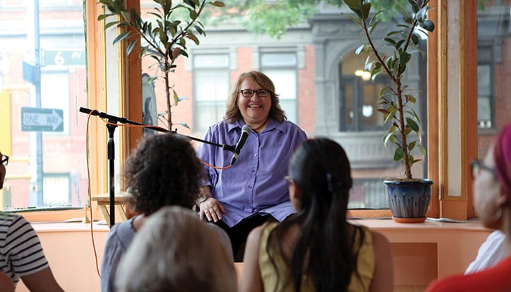"Salzberg teaching on ""Real Love"" at Brooklyn Yoga School. ""I had never been so happy,"" she says of learning <em>metta</em> practice. Photo by Fabio Fillippi."