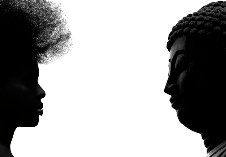 Buddha facing African-American woman.