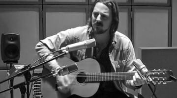 Sturgill Simpson playing guitar.