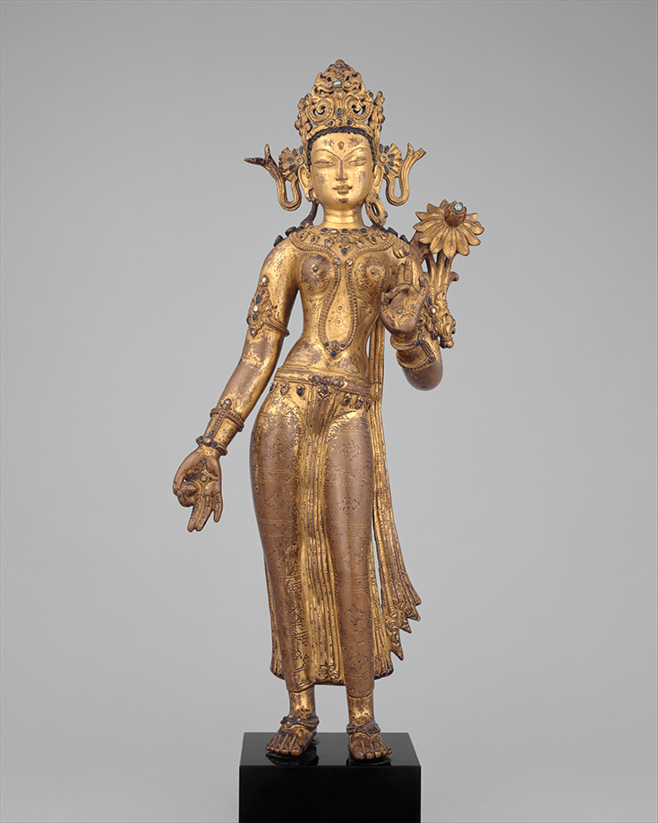 """Tara, the Buddhist Savior"" Malla Period. 14th century Nepal. Gilt copper alloy with color, inlaid with semiprecious stones. Photo courtesy of The Met."