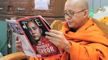 Radical Buddhist monk Ashin Wirathu reading a TIME magazine article about himself.