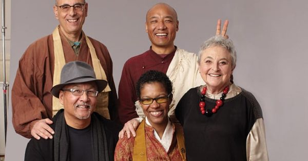 angel Kyodo williams (bottom center), with (clockwise), Larry Yang, Norman Fischer, Anam Thubten, and Sylvia Boorsten, in an outtake from the cover shoot for Lion's Roar #1.