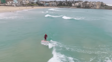 Gyuto monk surfing in Bondi Beach, Australia