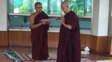 Thein Sein, right, is seen standing near a fellow monk at a monastery in Pyin Oo Lwin, Mandalay Division.