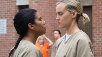 "Jessica Pimentel as Maria Ruiz with Taylor Schilling as Piper Chapman on ""Orange Is the New Black."""