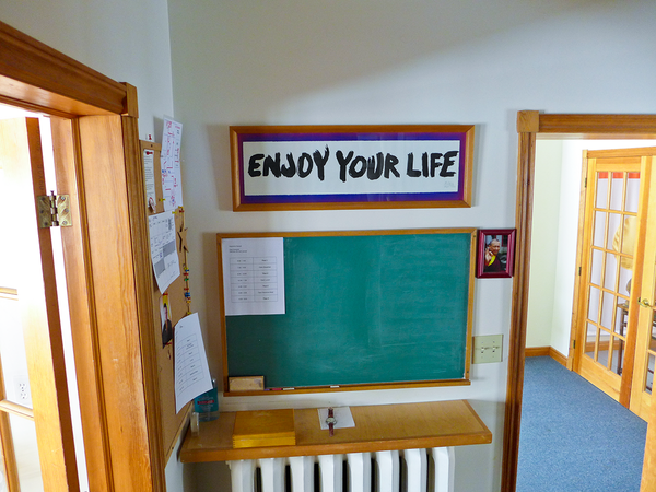 "Photo of ""Enjoy Your Life"" calligraphy hanging at Gampo Abbey."
