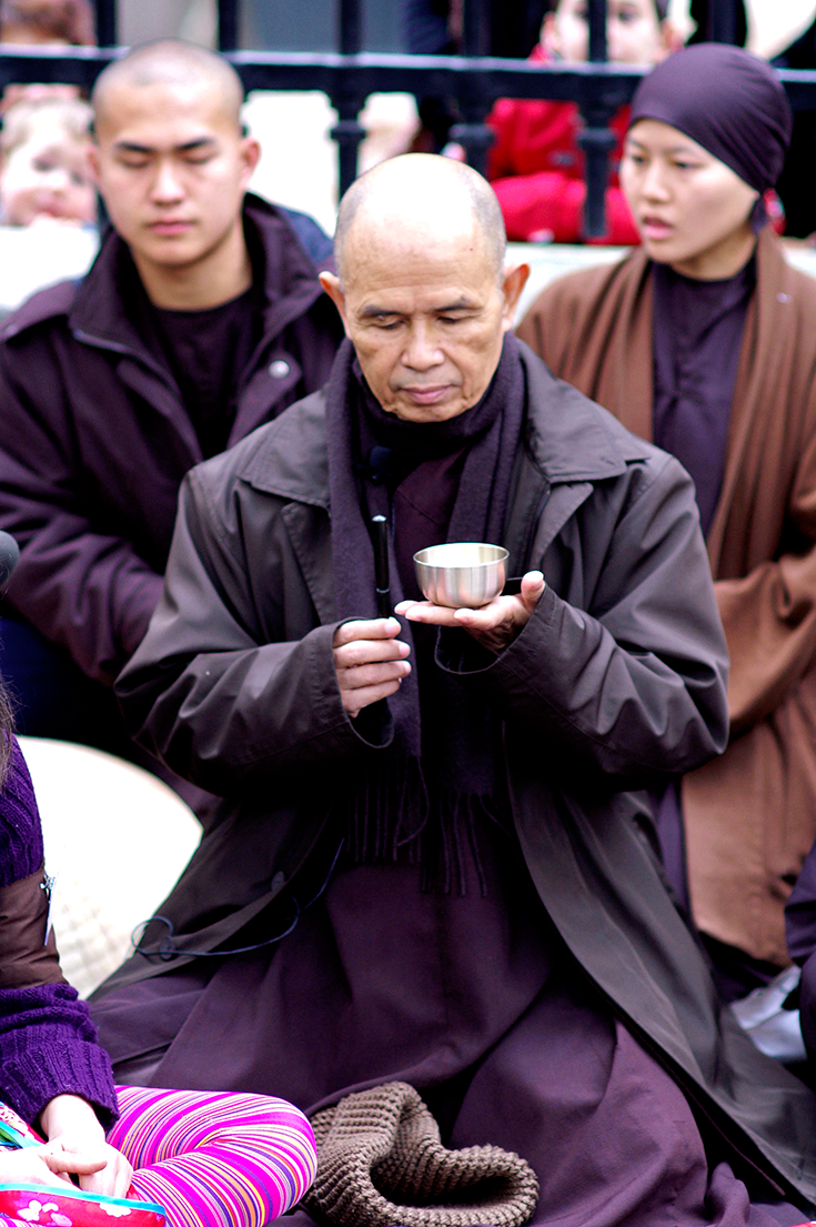 Thich Nhat Hanh holding a singing bowl.