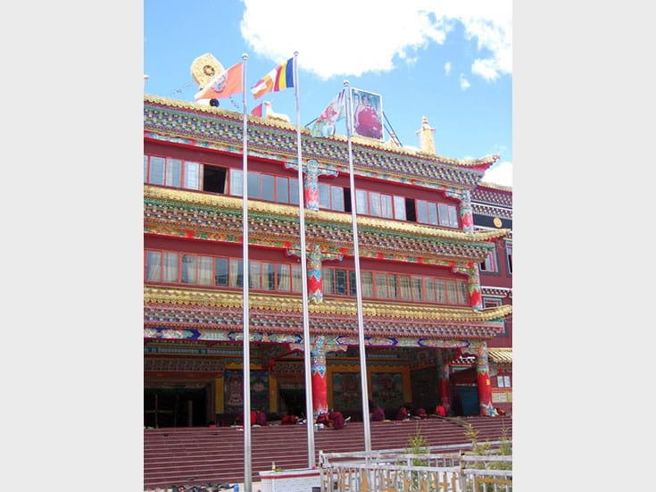 The Khenpo's photo above the main assembly hall for monks. Photo by Holly Gayley.