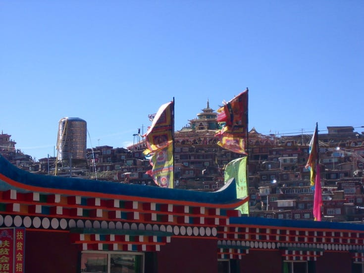 Banners Flying in the Wind at Larung Gar. Photo by Holly Gayley.