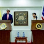 Aung San Suu Kyi and John Kerry address reporters.