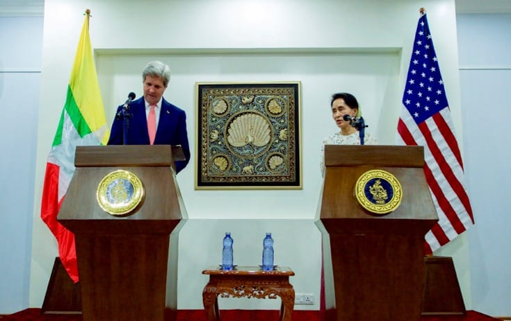 Aung San Suu Kyi and John Kerry address reporters.
