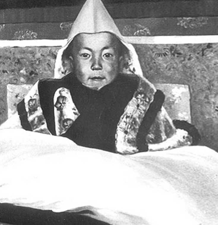 The 14th Dalai Lama as a young boy. Image via public domain.