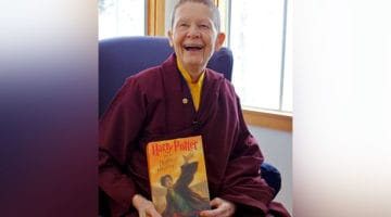 "Pema Chodron holding ""Harry Potter""."