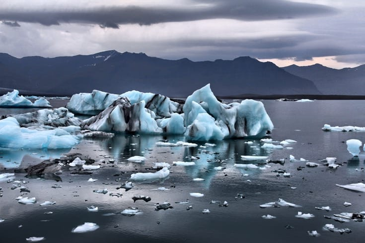 Icebergs breaking up in the water near iceland. Buddhists, Climate Change.