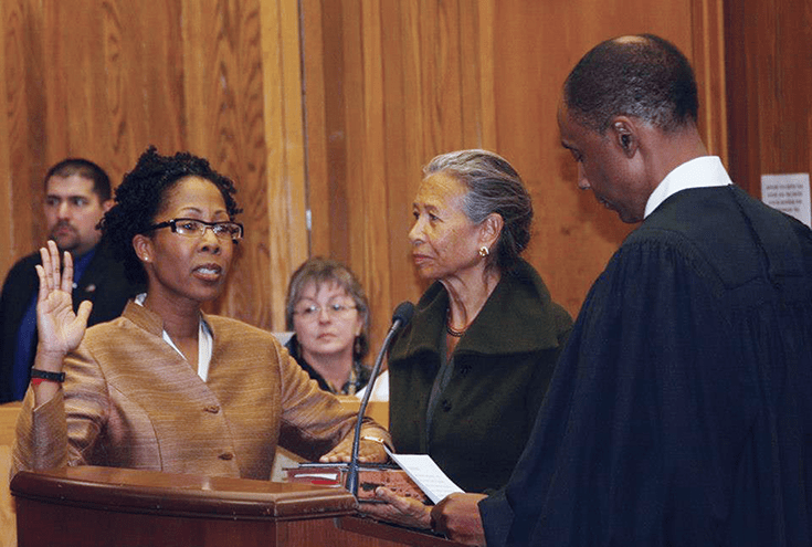 Gretchen Rohr, in a 2013 ceremony, is installed as a magistrate judge in the D.C. Superior Court by Superior Court Chief Judge Lee F. Satterfield. To her left is her Buddhist teacher, Gina Sharpe, founder of New York Insight.