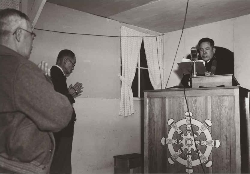 Buddhist service at Manzanar Relocation Center in California, where many Japanese Americans were incarcerated during the Second World War (1943). Photo courtesy the Library of Congress, Prints & Photographs Division LC-A35-6-M-36.
