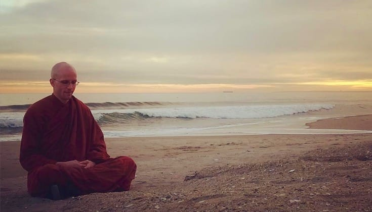 Buddhist monk Bhante Suddhaso meditating on Rockaway Beach.