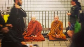 Monks meditating in the New York subway.