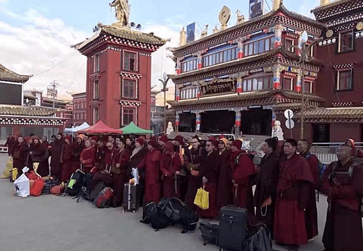Buddhist monks and nuns wait to be taken away from Larung Gar. Via Radio Free Asia.