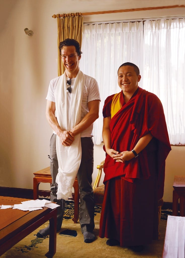 Benedict Cumberbatch smiling, standing with Dilgo Khyentse Yangsi Rinpoche.