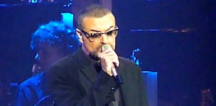 "George Michael sings on his ""Symphonica"" tour, 2011. (Photo by Frantogian, Creative Commons.)"