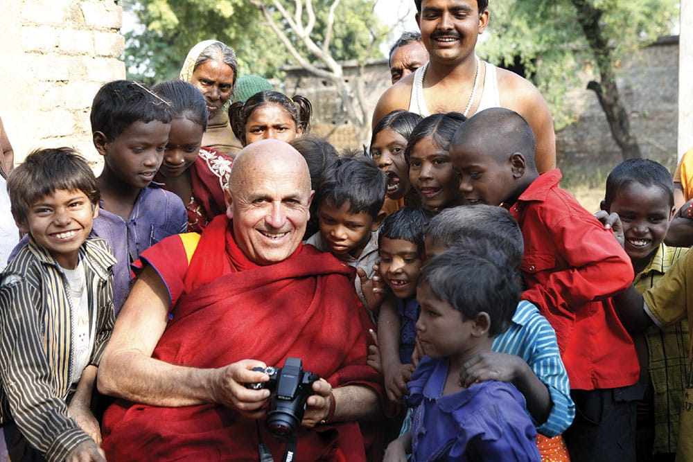 Matthieu Ricard shows his photography to children in one of the remote villages in Bihar, India, that are helped by his humanitarian organization, Karuna-Shechen. Photo by Shamsul Aktar.