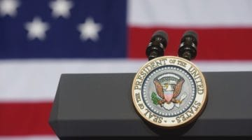Presidential seal on a podium.