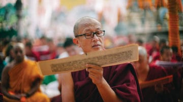Dzongsar Khyentse Rinpoche reading a Buddhist text.