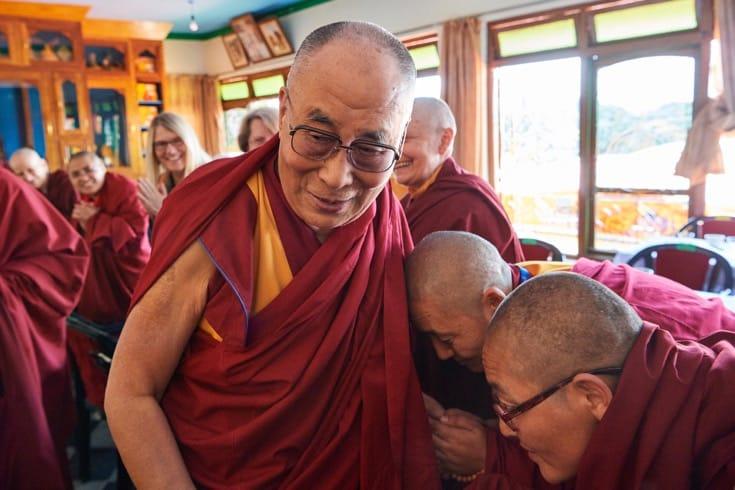 Nuns bowing before the Dalai Lama.