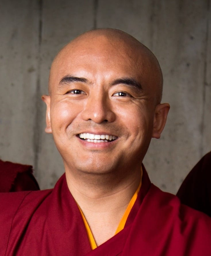 A portrait of smiling Yongey Mingyur Rinpoche.