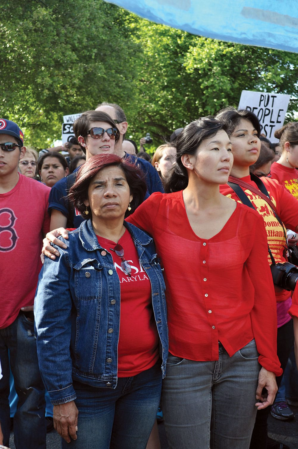 Ai-jen Poo (right) marching with the National Domestic Workers Alliance in Washington. She fights for living wages, benefits, and legal protections for caregivers and other domestic workers. Photo by Bekah Mandell.