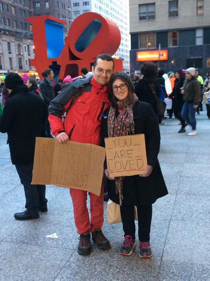 """Emily Herzlin and her """"You Are Loved"""" sign at the Women's March."""