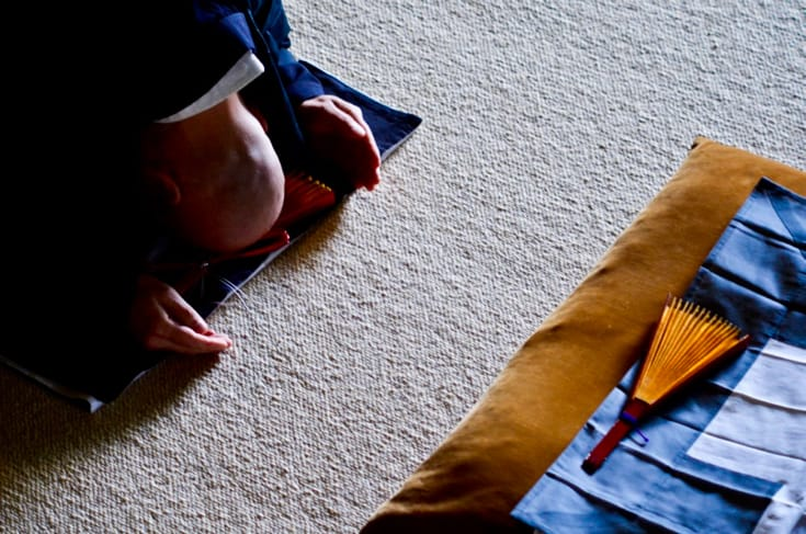 Zen monk bowing.